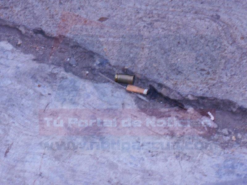 Cartucho 9mm colectado en el lugar del hecho por efectivos del Cicpc