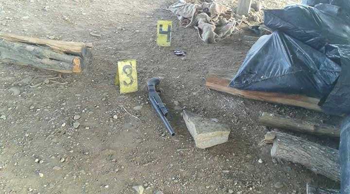 Arma de fuego colectada en el lugar.